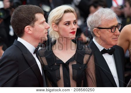 CANNES, FRANCE - MAY 11, 2016: J. Eisenberg,  K. Stewart, W. Allen attends the 'Cafe Society' premiere and the Opening Night Gala. 69th annual Cannes Film Festival at the Palais des Festivals