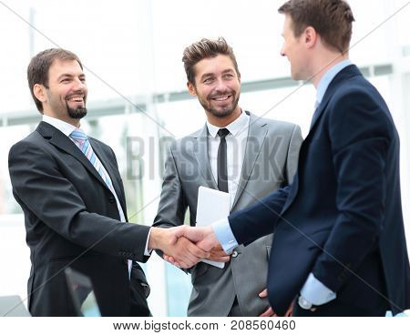 Two business people shaking hands at the business meeting
