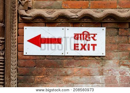 Exit sign and arrow in nepali and english