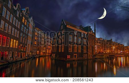 City scenic in Amsterdam the Netherlands at night by half moon