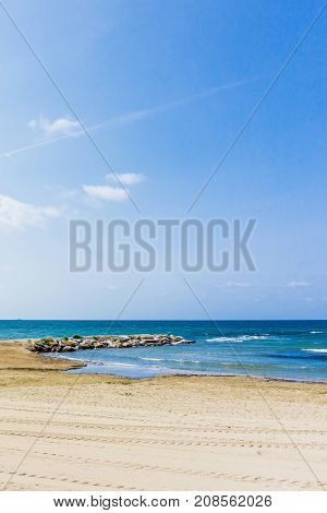View From The Follonica Beach On Stone Breakwater