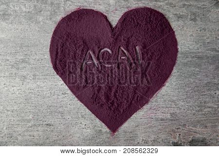 Composition with acai powder on grey background