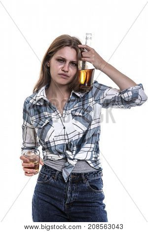 Drunk woman with glass and bottle of alcohol drink on white background