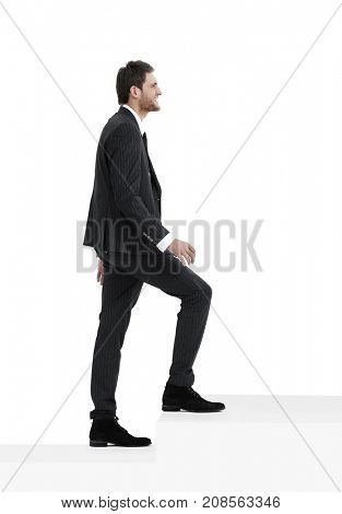 full growth.businessman taking a step forward.isolated on white.