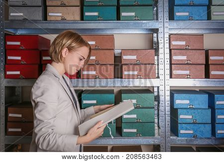Woman with documents in archive poster