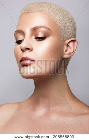 Beauty portrait of model with natural make-up and short hair