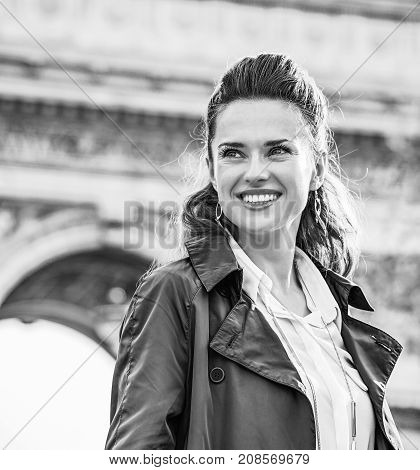 Happy Young Trendy Woman In Paris, France Looking Aside