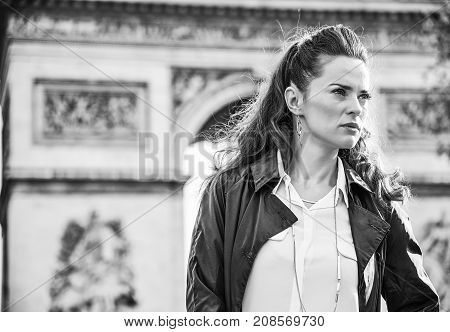 Trendy Woman In Trench Coat In Paris, France Looking Aside