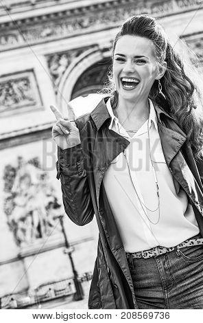 Fashion-monger Near Arc De Triomphe Showing Victory Gesture