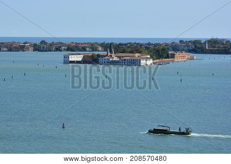 The view from the top of the bellltower of San Giorgio Maggiore church in Venice showing the island of San Servolo formerly a convent and then a psychiatric institution now a university building