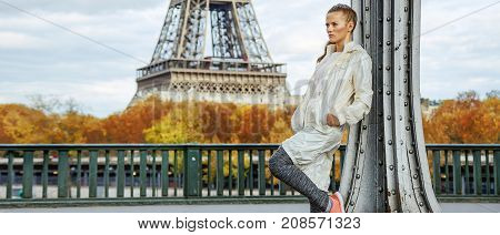 Healthy Woman On Pont De Bir-hakeim Bridge Looking Into Distance