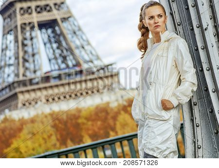 Fitness Woman Against Eiffel Tower Looking Into Distance, Paris