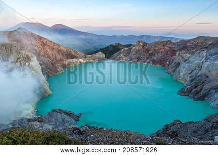 Colorful Ijen Volcano Crater Lake And Raung Volcano At The Background.