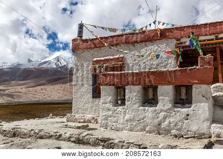 Gompa - Tibetan Buddhist Temple In Ladakh, North India. Traditional Buddhist Temple With Mountains O