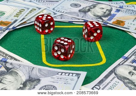 Dice rolls on a dollar bills Money. Green Poker table at the casino. Poker game concept. Playing a game with dice. Casino dice rolls. Concept for business risk. chance good luck