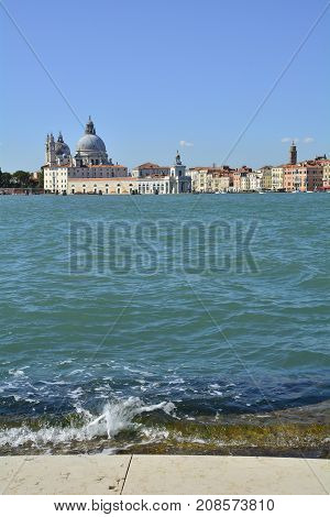 A view of Dorsodoro in Venice taken from the San Giorgio Maggiore with the Giudecca Canal on the left and the Grand Canal on the right. The church of Santa Maria Della Salute (Saint Mary of Health) can be seen towering above the other buildings and Punta