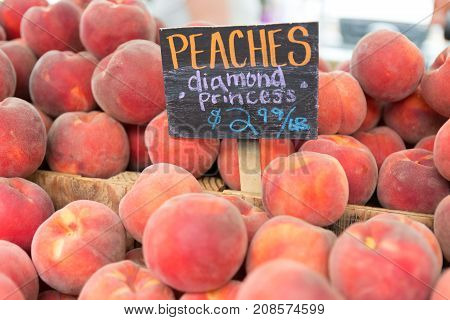Red Ripe Peaches At The Farmers Market