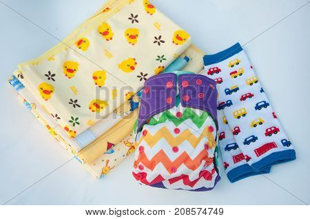Baby napkins reusable diapers gaiters with different patterns on white background