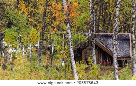 BJORKLIDEN, SWEDEN ON SEPTEMBER 13. View of a small Chapel, worship next to the Navvy Cemetery on September 13, 2017 in Bjorkliden, Sweden. Autumn, fall. Editorial use.