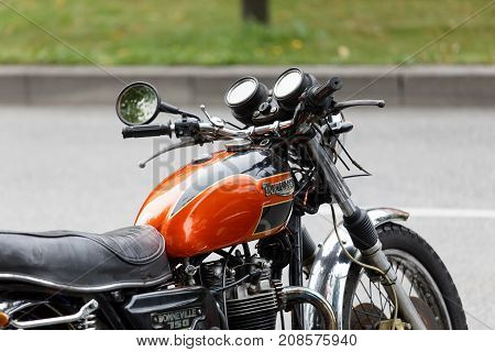 STOCKHOLM SWEDEN - SEPT 02 2017: Closeup of shiny red oldfashioned retro motorcycle at the Mods vs Rockers event at the Saint Eriks bridge Stockholm Sweden September 02 2017