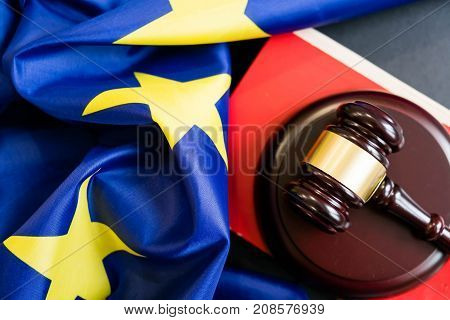 Judges Wooden Gavel With Eu Flag In The Background. Symbol For Jurisdiction. Wooden Gavel On Europea