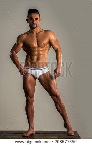 Man In Sexy White Lingerie. Naked Torso. Athlete Young Handsome. Personal Fitness Trainer. Power Ath
