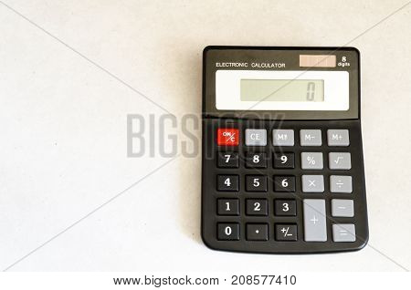 A Studio Photograph Showing A Calculator Ready for Use