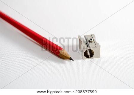 A Studio Photograph of a Pencil and a Pencil Sharpener