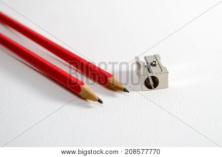A Studio Photograph of some Pencils and a Pencil Sharpener