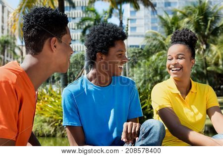 Relaxing african  young adults outdoor in the summer