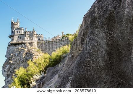 The castle is on top of a cliff. Small Castle Lastochkino Nest and its surroundings.