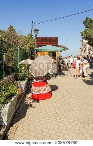 Yalta, Crimea - 11 July, The girl is under the umbrella, 11 July, 2017. Small Castle Lastochkino Nest and its surroundings.