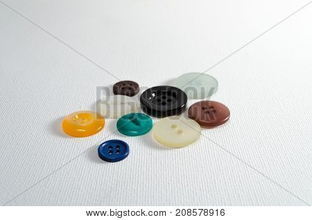 A Studio Photograph of Assorted Multicoloured Buttons