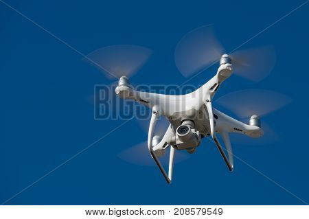Drone  With High Resolution Digital Camera On The Sky