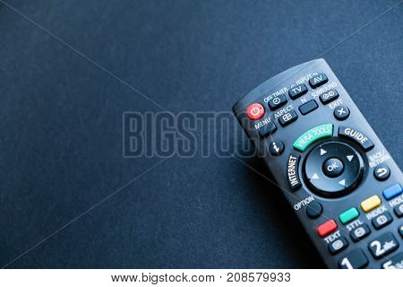 Remote Controllers On A Table. Top View, Flat Lay. Close Up On A Black Background. Copy Space For Te