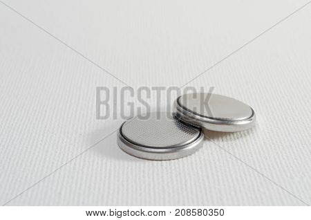 A Close-up Studio Photograph of Button Cell Batteries CR2032