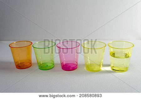 A Studio Photograph of Multicoloured Plastic 'Shot' Containers