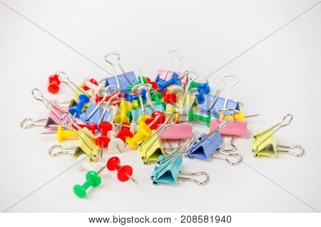 A Studio Photograph of a Group of Bulldog Clips and Drawing Pins