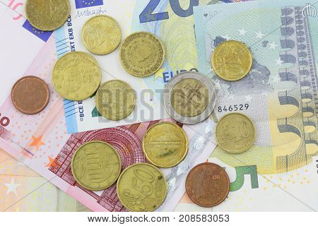 Euro banknotes and coins close uup in studio.