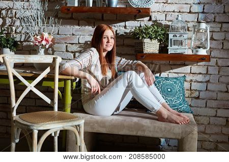 Young woman sitting at vintage home.