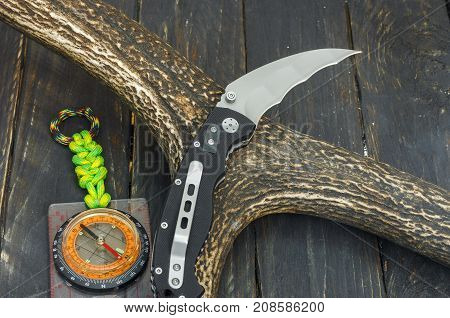 Knife With Radial Hawkbill Blade.