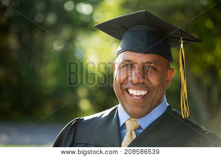 Middle age man going back to school. Graduation.