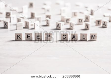 keep calm phrase collected of wooden elements with the letters