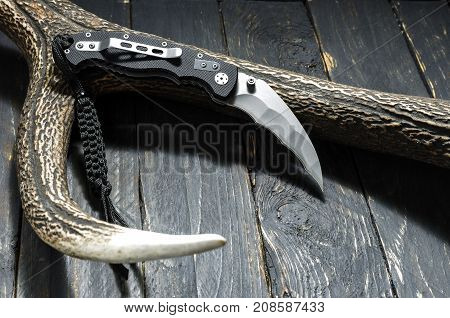 Knife With A Pocket Clip For Military Operations.