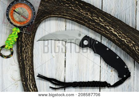 Black Knife With Black Lanyard.