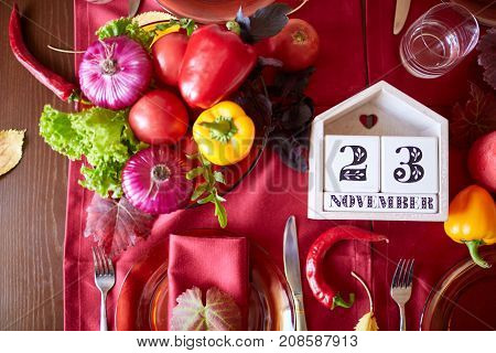 A top view on organic vegetables. Green onion, dill, parsley, tomatoes, celery, sorrel and many other vegetables in wooden plates. Close-up of vegetables. Food concept.