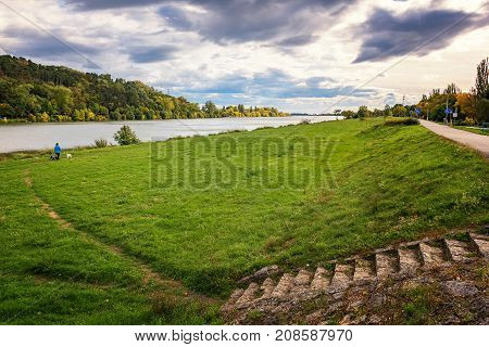 Riverbank Of Vah River In Piestany (slovakia) - Woman With Dogs