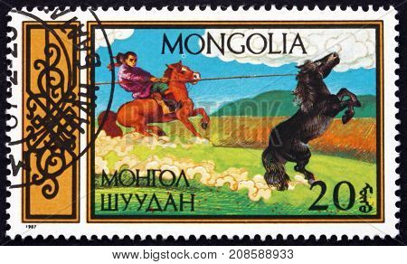 MONGOLIA - CIRCA 1987: a stamp printed in Mongolia shows Lassoer Traditional Equestrian sports circa 1987
