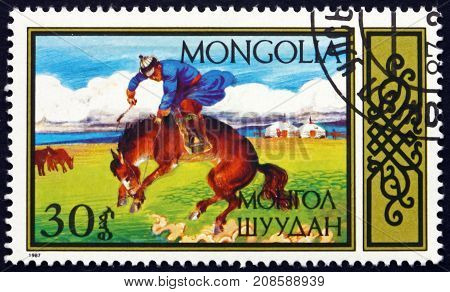 MONGOLIA - CIRCA 1987: a stamp printed in Mongolia shows Breaking Horse Traditional Equestrian sports circa 1987