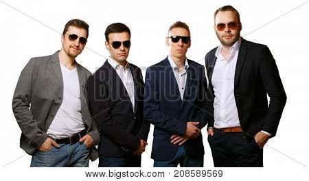 Group of male friends isolated on white background. Friendly team, harsh guys in sunglasses and suits. Angry guards or business colleagues.
